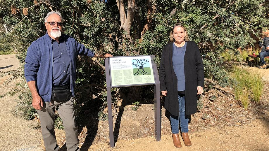 Ngunawal elder Wally Bell and Ngunawal woman Karen Dennywhose artwork 'Scar and Ring Tree' appears on the garden's welcome sign