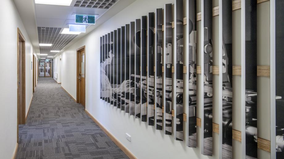 Historic photographs interpreting the work conducted in the John Curtin School were  printed on 3D surfaces, in order to change depending on the direction they were viewed. (Stuart Hay)