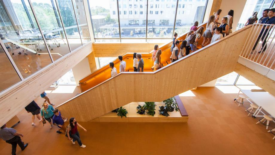 ANU Kambri building with students going up and down the stairs.